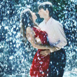 Young couple passion in the rain — Stock Photo