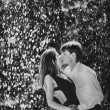Young couple passion in the rain — Stock Photo #27490159