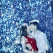 Stock Photo: Young couple passion in the rain