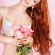 Stock Photo: Picture of tempting womin sexy lingerie with flowers