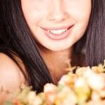 Portrait of a woman with golden flowers bouquet — Stock Photo