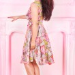 Full length portrait of a woman in a pink room — Stock Photo #27491105