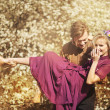 Happy young couple in a park of cherry blossom — Foto Stock