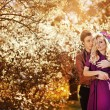 Happy young couple in a park of cherry blossom — Stock Photo #27492281