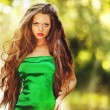 Young beautiful lady in green dress — Stock Photo #27925477