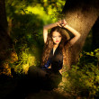 Beautiful girl in black dress in fairy forest — Stock Photo #27925523