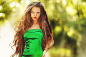 Young beautiful lady in green dress — Stock Photo