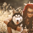 Shaman girl in the woods with the dog — Stock Photo