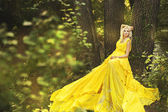 Photo of young beautiful lady in fairy forest — Stock Photo
