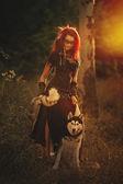 Dívka šaman v lese se psem — Stock fotografie