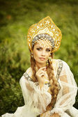Russian beauty in headdress — Stock Photo