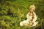 Russian beauty in headdress — Stock Photo