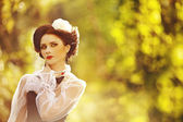 Beautiful Russian woman in a vintage dress — Stock Photo