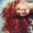 Beautiful red-haired girl with long hair — Stock Photo