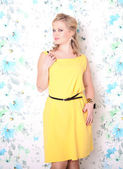 Pretty happy active female blond hair woman in yellow prom dress posing. Fashion style. — Stock Photo