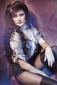 Beautiful brunette posing in seductive wear — Stock Photo