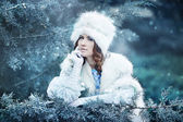 Beautiful snow queen in winter forest — Stock Photo