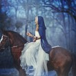 Beautiful blonde girl in white dress on a horse — Stock Photo #40638307