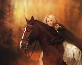 Girl with a horse in the park — Stock Photo