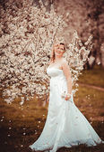 Beautiful blond girl in blossom garden — Стоковое фото