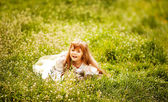 Little girl in a long dress vintage — Stock Photo