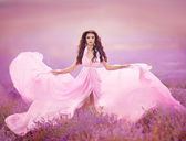 Beautiful woman on lavender meadow — Foto Stock