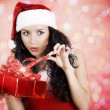 Beautiful girl with gifts for Christmas — Stock Photo #9599214