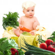 Cute baby chef with big pot and vegetables — Stock Photo