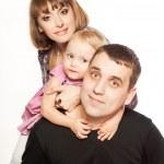 zabawy i szczęśliwy twarze rodziny — Zdjęcie stockowe #21387139