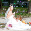 The bride and soap bubbles — Stock Photo #21712379