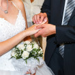 Groom wears the ring bride - Stock Photo