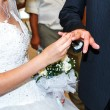 The bride wears the ring to the groom at a wedding — Stock Photo