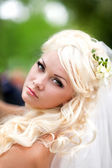 Portrait of an young bride with beautiful wedding hairstyle — Stock Photo