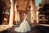 Bride in the columns — Stock Photo