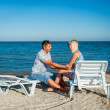 Happy couple enjoying vacations on the beach — Stock Photo