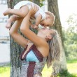 Stockfoto: Happy mother with adorable baby