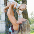 Foto Stock: Happy mother with adorable baby