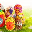 Decorated easter eggs in the grass with daisies — Stock Photo #43968879