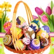 Decorated easter eggs in the grass with daisies — Stock Photo #43968961