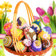 Decorated easter eggs in the grass with daisies — Stock Photo