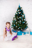 Happy little girl at the christmastime — Stock Photo