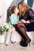 Mother and little daughter with flowers. Close Up Of Affectionate Mother And Daughter At Home — Foto Stock