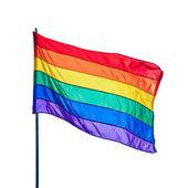 Tęczowa flaga dumy gejowskiej na tle błękitnego nieba — Zdjęcie stockowe