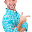 Royalty-Free Stock Photo: Smiling man pointing at something interesting