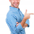 Smiling man pointing at something interesting — Stock Photo