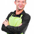 Happy man with an apron isolated on a white background — Stock Photo