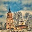 Orthodox church on the bank of the frozen river — Stock Photo
