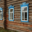 Windows in a rustic wooden house — Stock Photo