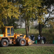Foto de Stock  : Tractor cleaning street