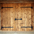 Large wooden door in an old country house — Stock Photo